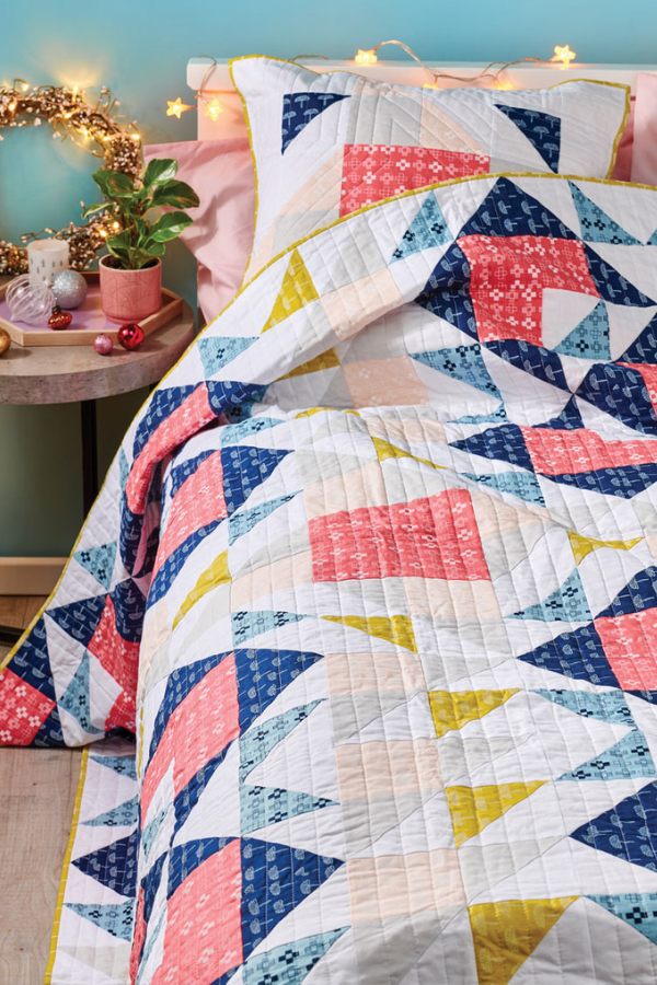 Double Windmill Quilt featured in Love Patchwork and Quilting Magazine Issue 67 | Shannon Fraser Designs #lovequiltingmag #homedecor #quiltsonbeds