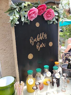 Mimosa Bar with Bubbly Bar sign