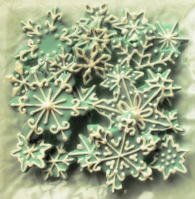 Turquoise and white decorated sugar snowflakes