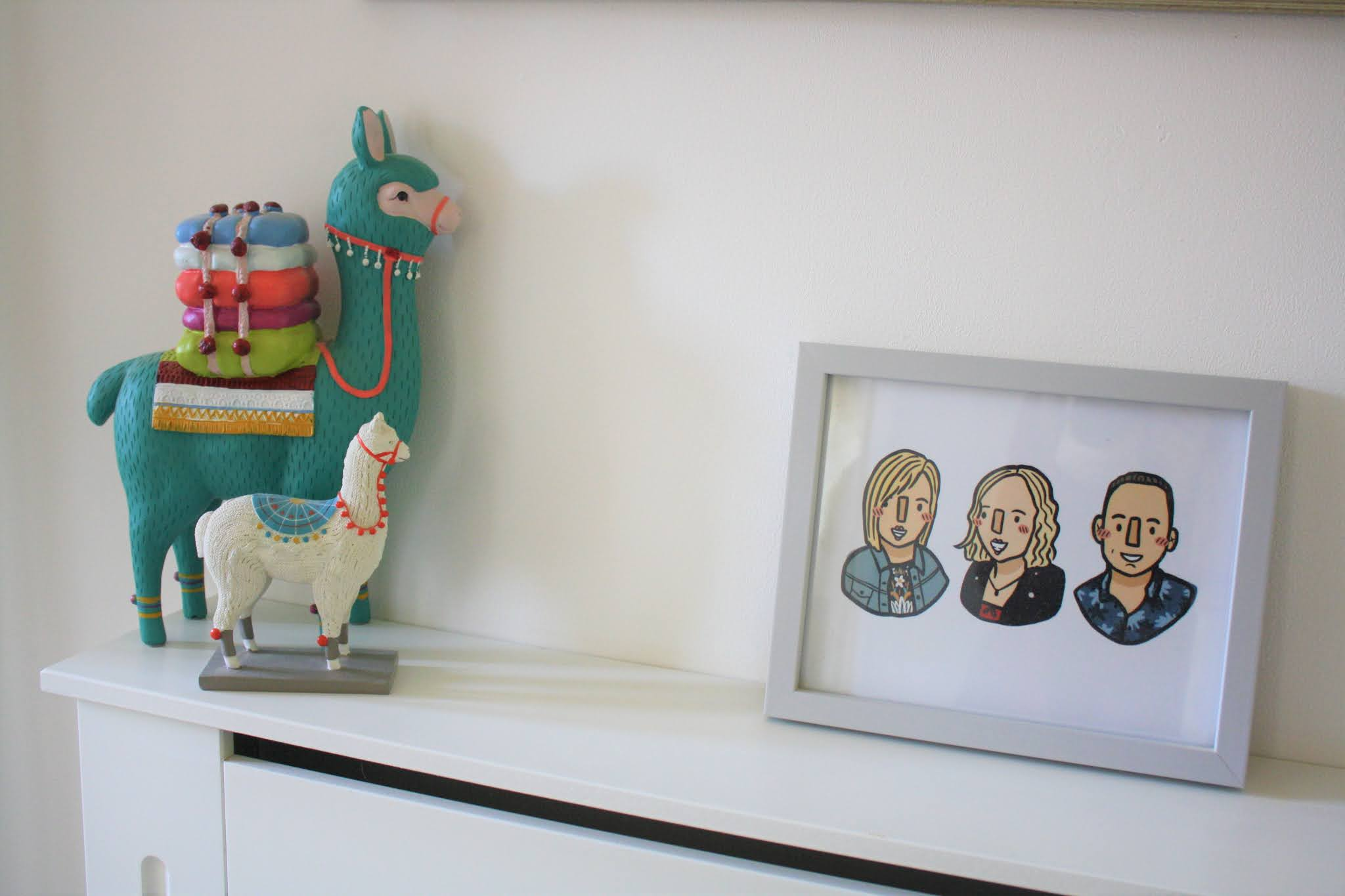 two brightly coloured llamas beside family photo frame in mini room renovation makeover