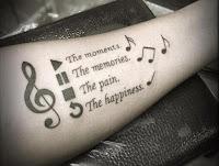 tatuaje de musica en el antebrazo