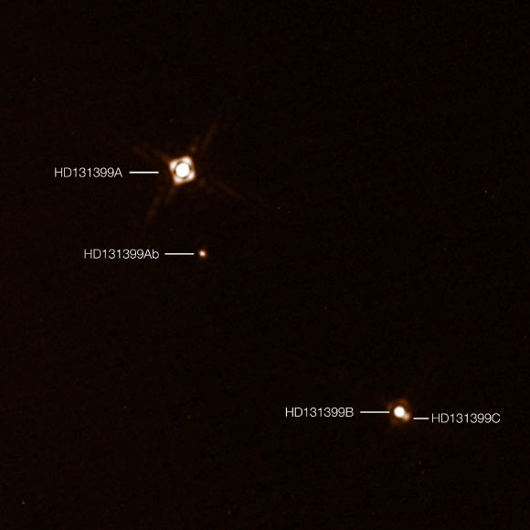 This annotated composite image shows the newly-discovered exoplanet HD 131399Ab in the triple-star system HD 131399. The image of the planet was obtained with VLT's SPHERE imager. Image credit: K. Wagner et al / ESO.