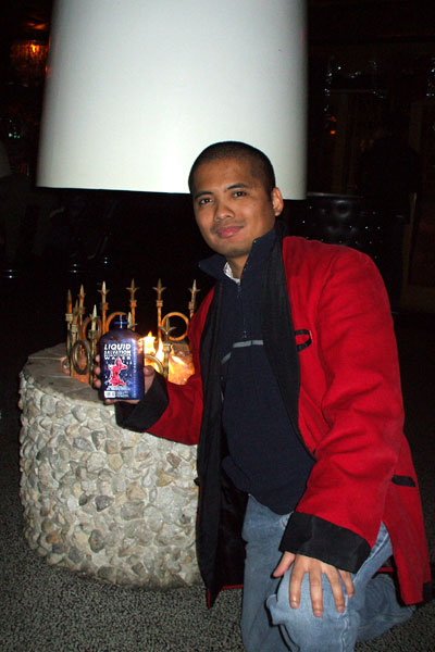 Posing with a cool-looking water bottle while wearing a nifty red jacket that I received from one of my assistant supervisors during the company Christmas party at Saints & Sinners tavern in west Los Angeles...on December 20, 2010.