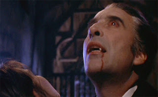 Dracula (Christopher Lee) scores his first victim in Dracula A.D. 1972