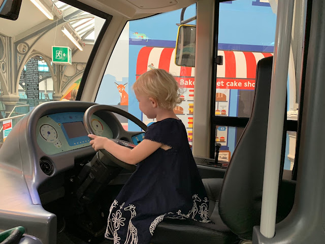 Driving a pretend bus in London Transport Museum