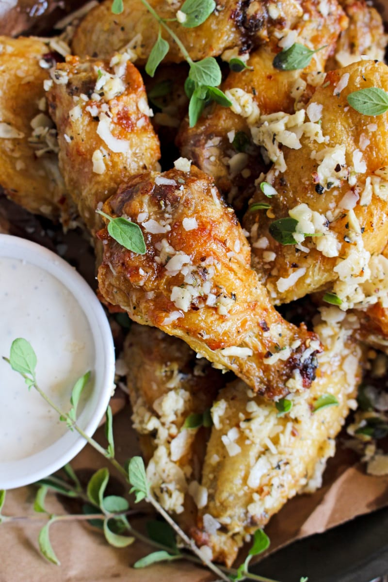 Air Fryer Garlic Parmesan Chicken Wings are extra crispy wings tossed in seasoned garlic butter sauce and parmesan cheese. Try them dipped in caesar dressing and you'll be hooked! #chickenwings #appetizer