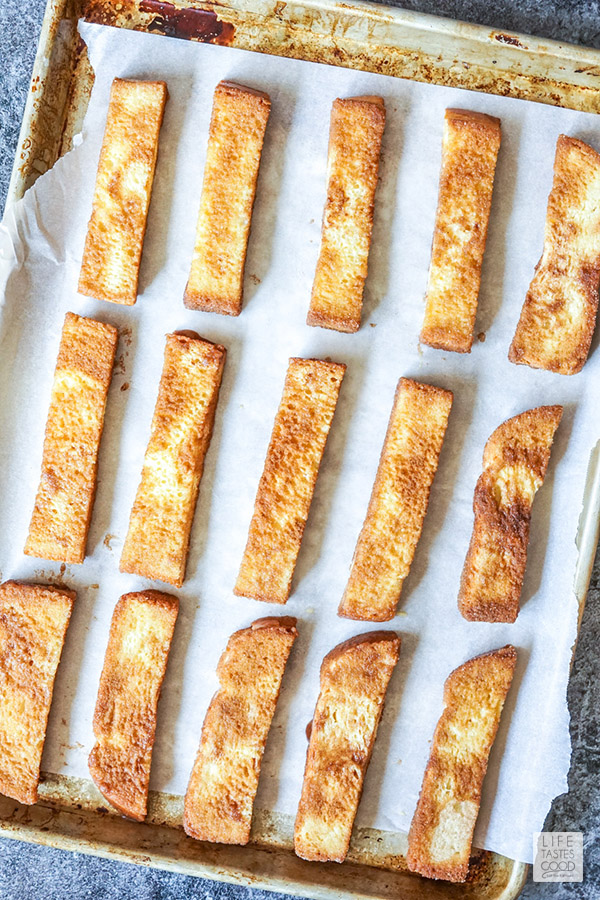 How to make french toast sticks- bread dipped in egg mixture and coated with cinnamon sugar ready to bake