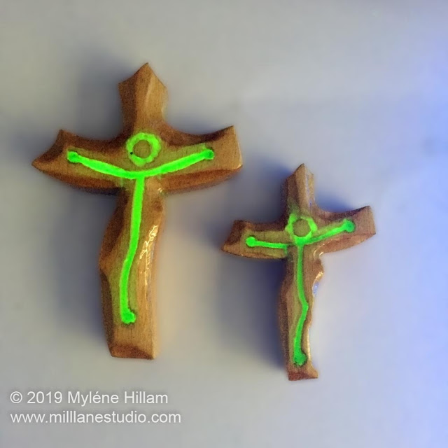 Resin and wood crucifix glowing in the dark