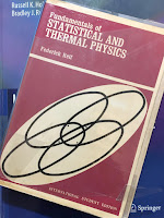 Fundamentals of Statistical and Thermal Physics, by Frederick Reif, superimposed on Intermediate Physisc for Medicine and Biology.