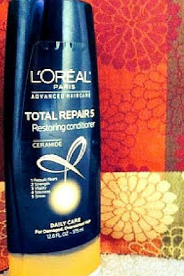 A review of L'Oreal Paris Ceramide Total Repair 5 Restoring Conditioner on relaxed hair.   arelaxedgal.com
