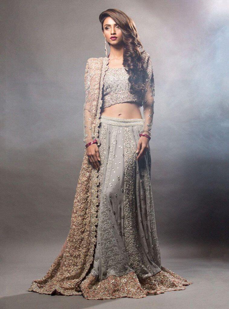 Bridal Heavy Embellished Choli featuring Swarovski crystals with floral net and chiffon paneled lehnga