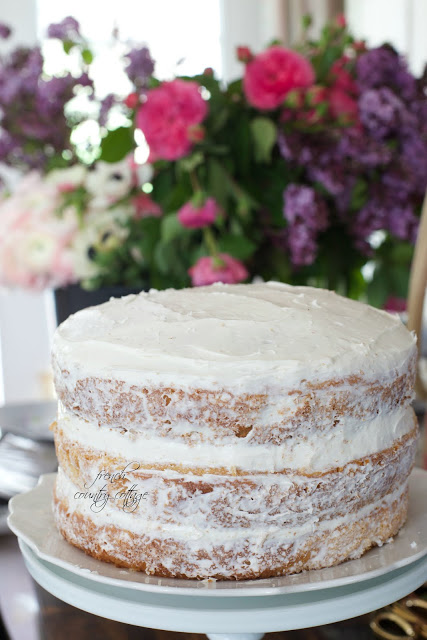 naked rustic cake with little frosting