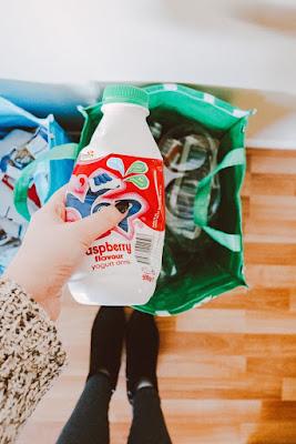 Woman recycling a bottle
