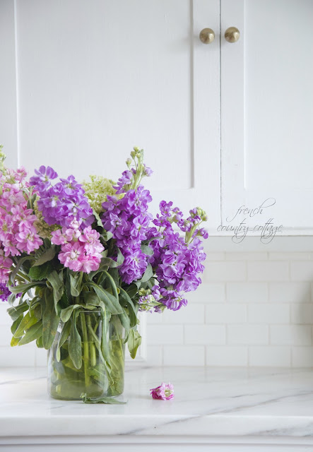 Marble counters with stock flowers in vase