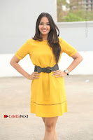 Actress Poojitha Stills in Yellow Short Dress at Darshakudu Movie Teaser Launch .COM 0013.JPG