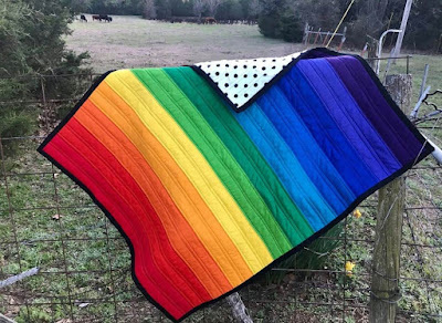 striped rainbow baby quilt.