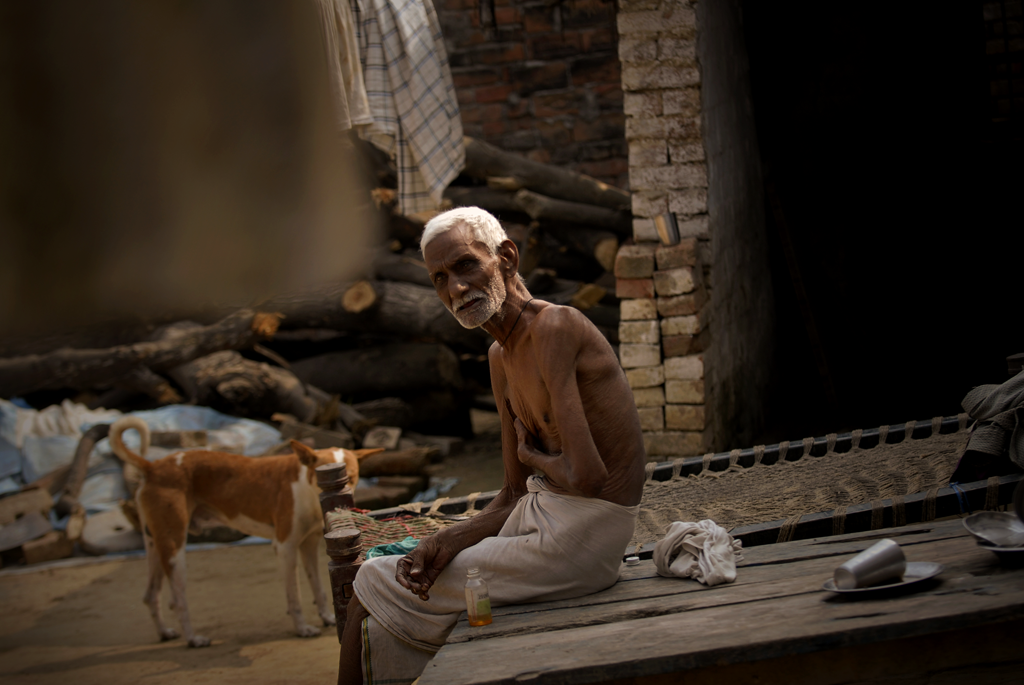 Photo of an old man in Varanasi, India submitted to the weekly challenge 'A Day in Your Life' on Better Photography.