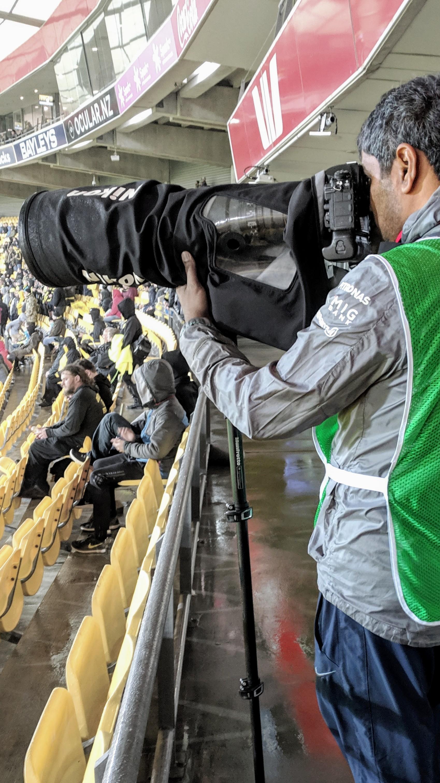 Telephoto lens on sport photographers camera