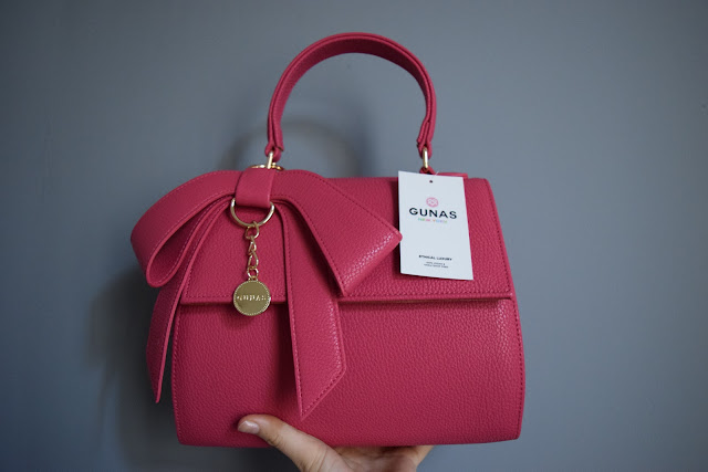 gunas handbags promo