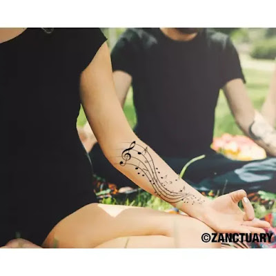Grey Ink Music Tattoo On Forearm
