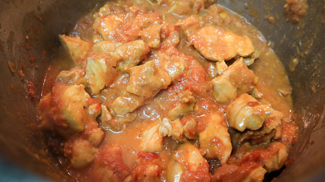 Butter Chicken in a pot while cooking