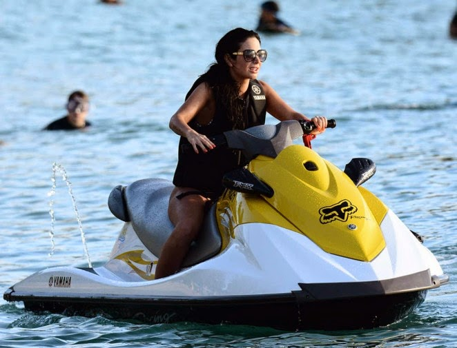Tulisa Contostavlos spotted jet skiing in Barbados
