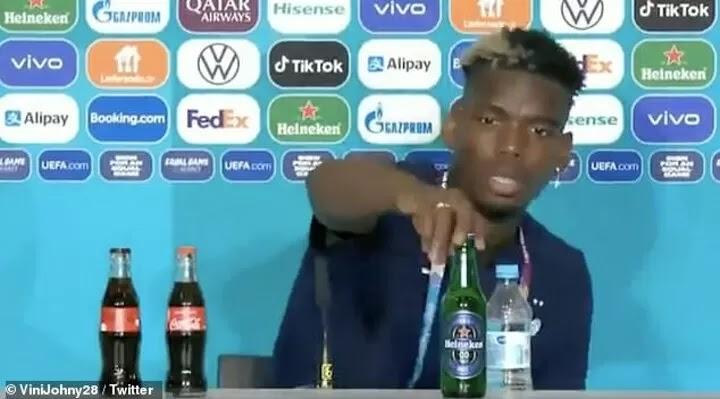 Paul Pogba removes Heineken beer bottle at press conference