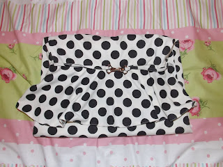A polka dot dress folded up