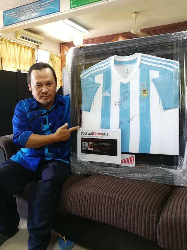 Ahmad Marzuki, winner of a Messi signed jersey