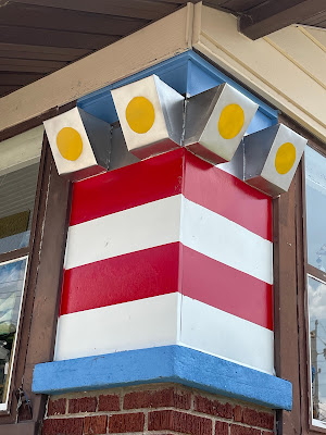 colorful closeup photo of red and white striped sears porch pillars Grafton Illinois coffee antiques shop Lightkeepers Coffee 101 E Main St Sears Vallonia