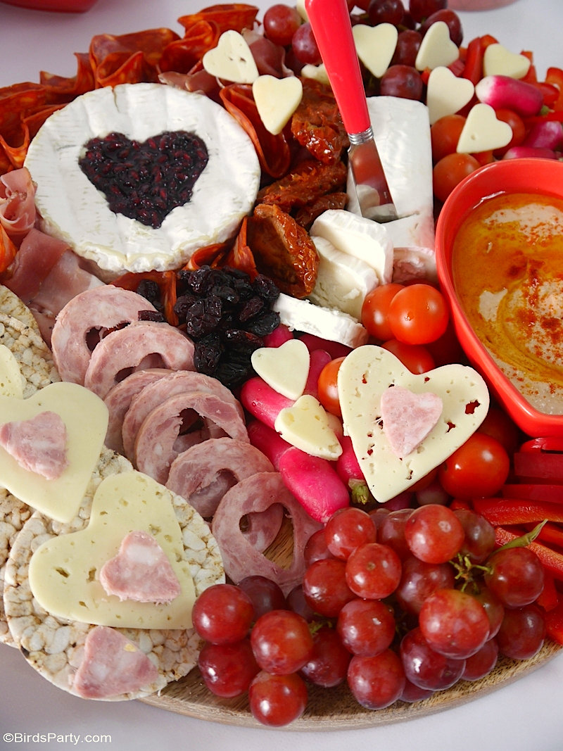 Valentine's Day Cheese and Charcuterie Board - easy, pretty, delicious grazing board filled with pink & red foods to celebrate love day at home! by BirdsParty.com @birdsparty #cheeseboard #charcuterieboard #valentinesday #recipes