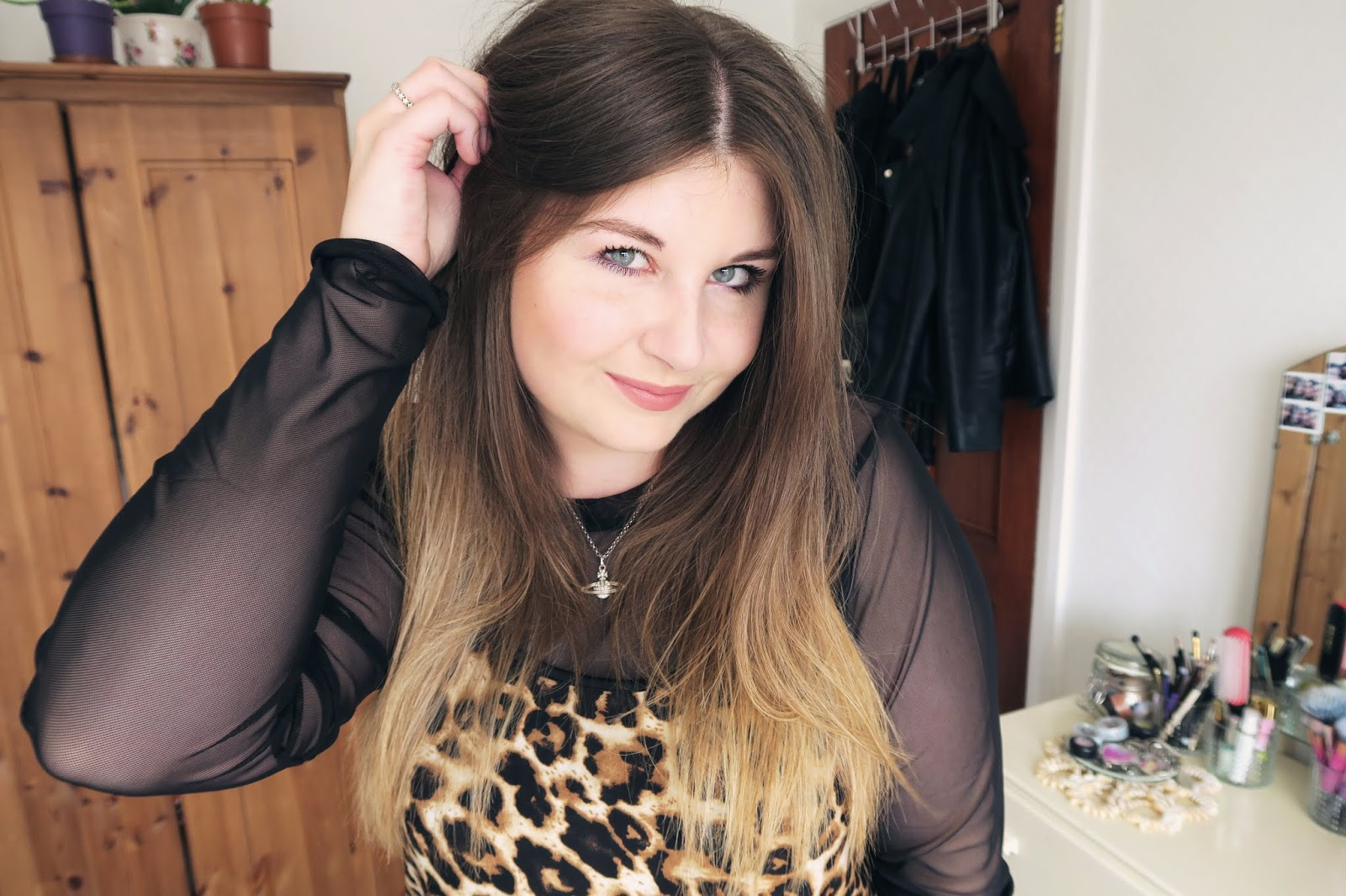Wearing a leopard print cami top with a black mesh top underneath