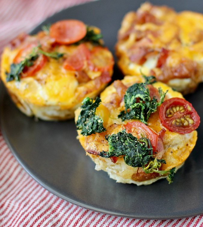 Individual Tater Tot Breakfast Casserole Muffins with spinach and tomato