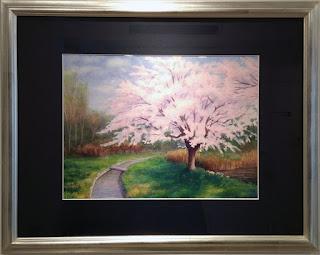 春の香りは風に乗って 水彩画 中野瑞枝 桜の木が一本、小川の傍らに立っています。