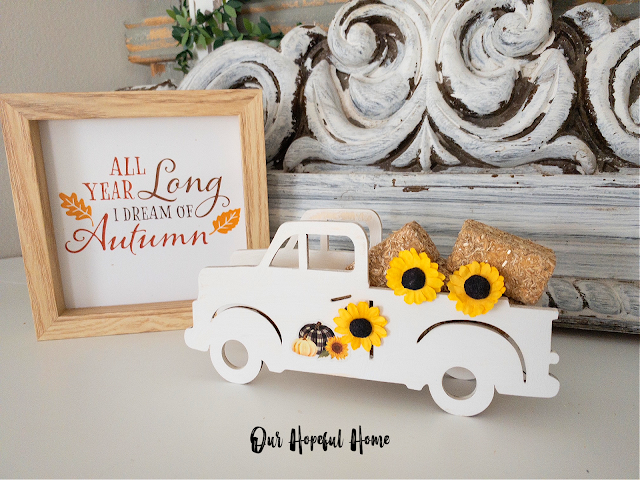 fall decor sign white truck hay bales sunflowers