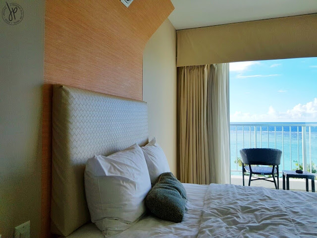 ocean view bedroom with balcony