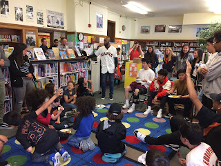San Francisco Giants player Austin Jackson in the Lafayette Elementary School library with students