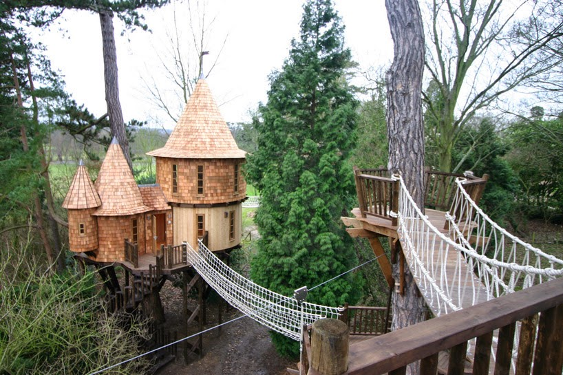 1. The tree house is made up of two sections. - This Family Lives In A Tree House That Looks Like A Castle. Think That's Cool? Wait Until You See The Inside.