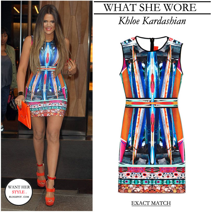 15df2bf5f82c WHAT SHE WORE  Khloe Kardashian wore a bright multi print orange and ...