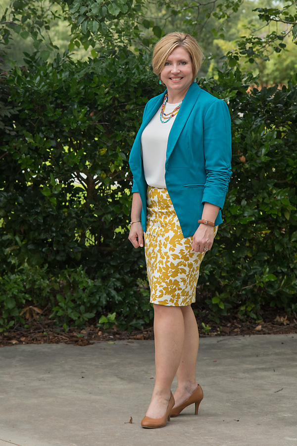 teal blazer with mustard print skirt