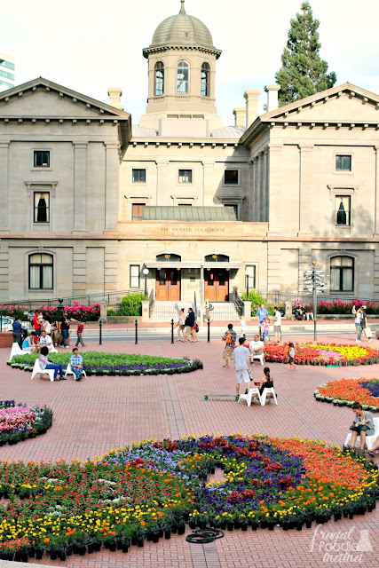 The Festival of Flowers at Pioneer Courthouse Square in Portland, OR works with local artists or a design firm each year to create an artistic masterpiece in the middle of the square using more than 20,000 potted flowers and plants.