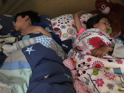 Children sleeping in a tent