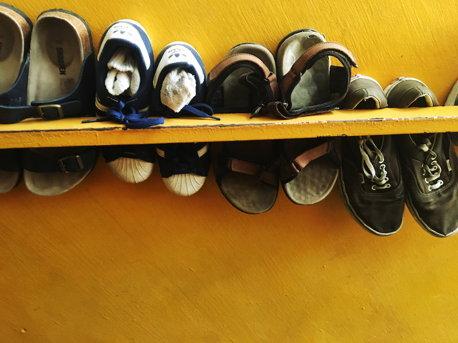 Shoes on the staircase in Ringo's Foyer Hostel Malacca