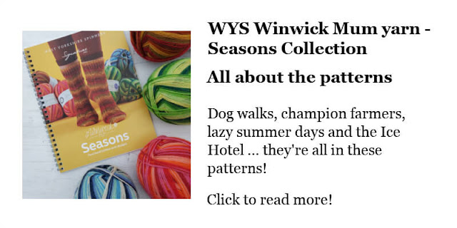 A pattern book for the Winwick Mum Seasons collection yarn surrounded by four balls of the yarn