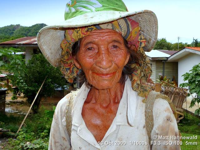 old Rungus woman, street portrait, headshot, sunhat, Borneo, Sabah, Kota Belud