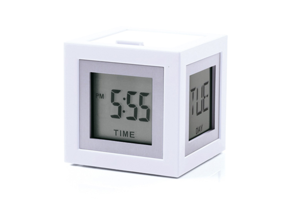 Kikkerland Sells A Tiny Alarm Clock With Stand For Just $15 (also Available  In Red And Black). They Have A Few Other Nice Looking Options, As Well.