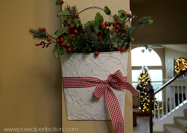 Tin bucket with frosted holly leaves and Christmas Greenery