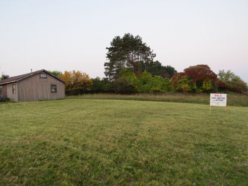 empty lawn with a sign