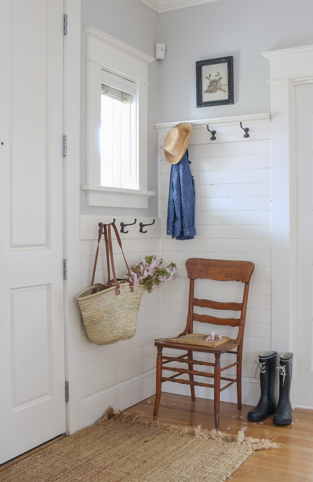 small entry with white shiplap and hooks