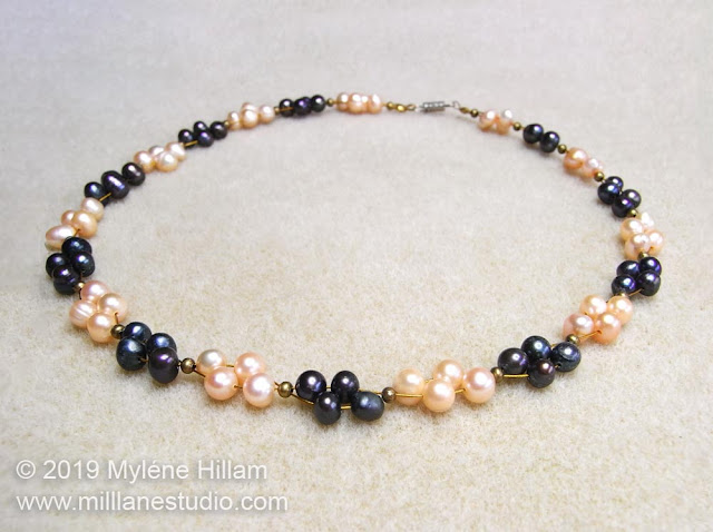 Pearl necklace strung with navy and peach coloured freshwater pearls